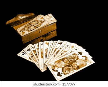 Old casino cards and card-box on black background.