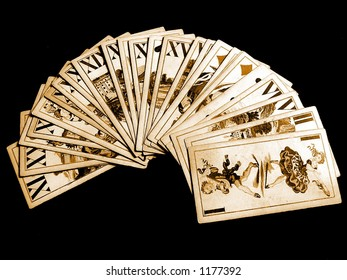 Old casino cards on black background.