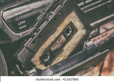 old cassette tape and player on the old brown wooden background