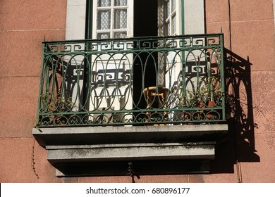 An old cast iron balcony on a building in the historical city of Porto, Portugal.