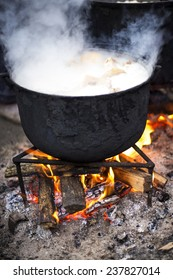 Old cast iron cooking outside