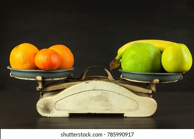 Old cast iron kitchen scale with fruit and vegetables. Healthy eating. Selling fruit