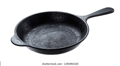 Old cast iron pan isolated on white background with clipping path, vintage empty skillet