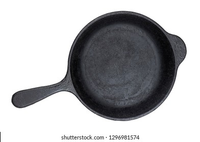 Old cast iron pan isolated on white background with clipping path, vintage empty skillet, top view