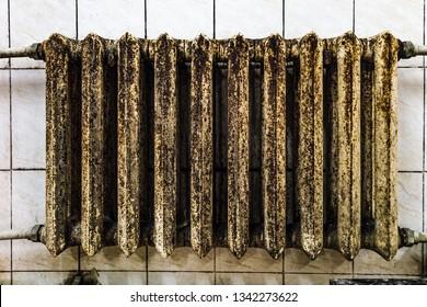 Old cast iron rusty moldy heating radiator