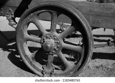 The old cast iron wheel of this ranch trailer is no longer serviceable (monochrome image).