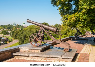 Old cast-iron cannon stands on a pedestal in a city park in Chernigov, Ukraine. Chernihiv is one of oldest cities of Kievan Rus.