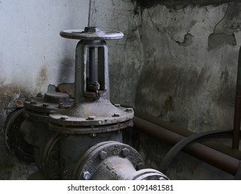 old cast-iron valve on the pipeline in basement