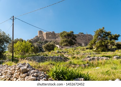 The old castle of Chrysocheria in Kalymnos island, Greece. The castle is situated midway between Hora and Pothia. Three stone windmills visible from the harbor, are the trademark of Kalymnos island.