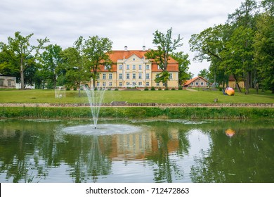 Old castle at Latvia, city Malpils. View from lake to castlle. 2015