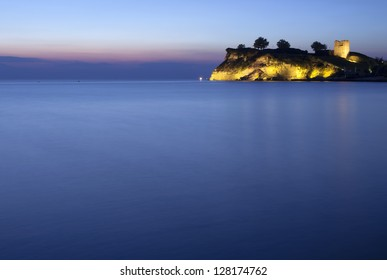 An old castle at the night sea