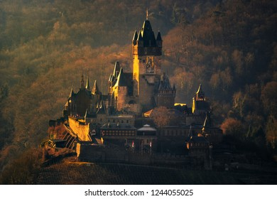old castle on the river Moselle. here the reichsburg of Cochem in a frontal photo, illuminated in winter by the sun