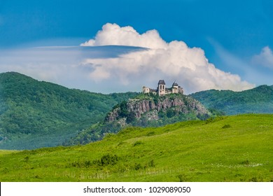 Old castle ruins and mountain background under blue sky and clouds. Hungary, Fuzer Castle. European Heritage site