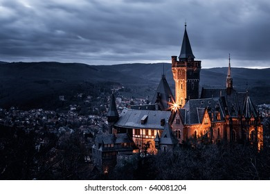 Old castle in Wernigerode with dramatic mystic sky