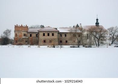 Old castle in winter on snow background in Starokostiantyniv, Khmelnytskyi region in Ukraine. Horizontal outdoors shot.