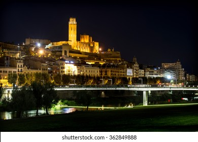 "Old Cathedral of Lleida, known as ""Seu Vella"", at nigh, seen from the city river."