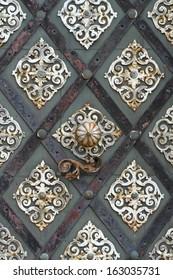 Old cathedral metal door in detail