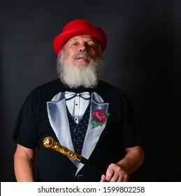 Old Caucasian male in red bowler hat displaying the me, me attitude of an egotist, egoist. Dapper old man showing his self love and conceit.