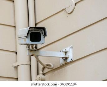 old cctv camera on wall