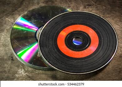 Old CDs On Wood
