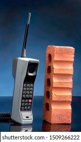 Old cell phone called the brick phone made in the early 1980's.