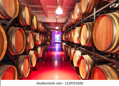 Old cellar winery interior with big wooden wine barrels