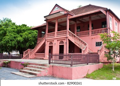 Old cement house. Painted with red, mixed with pink. Address City Chonburi Thailand