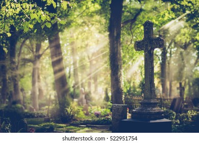 Old cemetery with a big cross. Latvia. Selective focus.