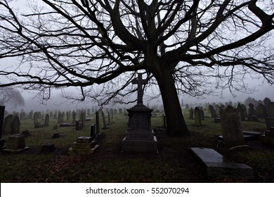Old cemetery headstones on a foggy day