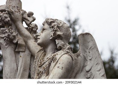 Old cemetery marble sculpture of the angel.