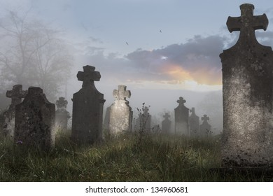 Old cemetery on a foggy morning,