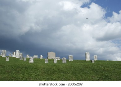 old cemetery with a thunderstorm looming in the background and a vulture circling overhead.