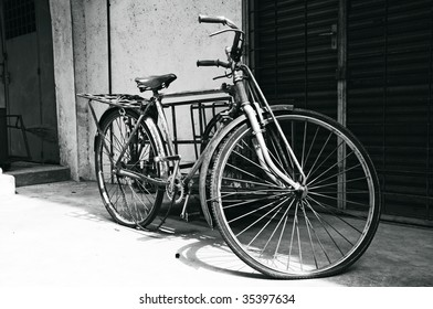 Old century bicycle used for transportation in black and white