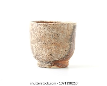 Old ceramic cup isolated on white background.