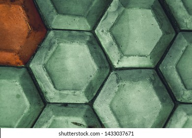 Old ceramic painted building tiling mint colour.