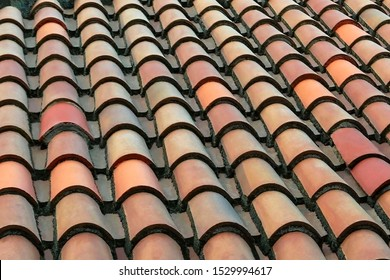 Old ceramic tile roof top. Terracotta texture background close up