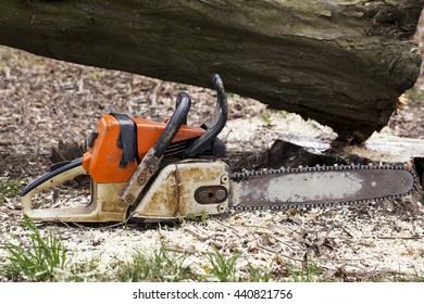 the old chainsaw is on a ground