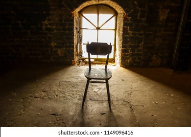 Old chair against the window