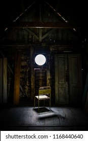 An old chair in front of circular window light
