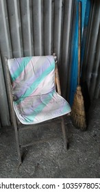 Old Chair and Wall with Broom