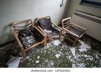 Old chairs at an abandoned and derelict lunatic asylum/hospital (now demolished), Cane Hill, Coulsdon, Surrey, England, UK