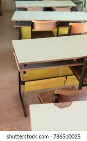 old chairs and bench in classroom in poor school, study room without student