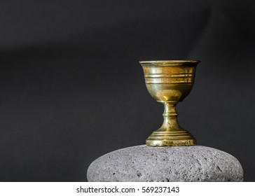 Old chalice on stone