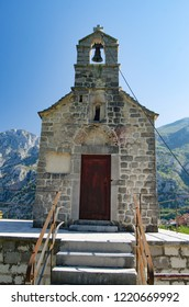 Old chapel with a bell tower on the background of the mountains. Stairs, Church and bell tower.Close up.
