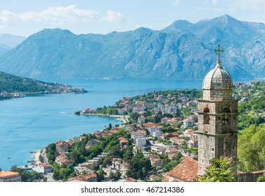 Old chapel and Kotor town and bay on the background from above with soft focus, Montenegro