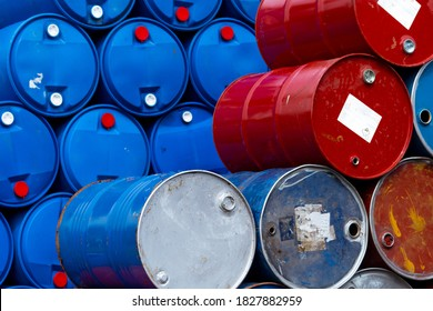Old chemical barrels. Blue and red oil drum. Steel and plastic oil tank. Toxic waste warehouse. Hazard chemical barrel with warning label. Industrial waste in drum. Hazard waste storage in factory.