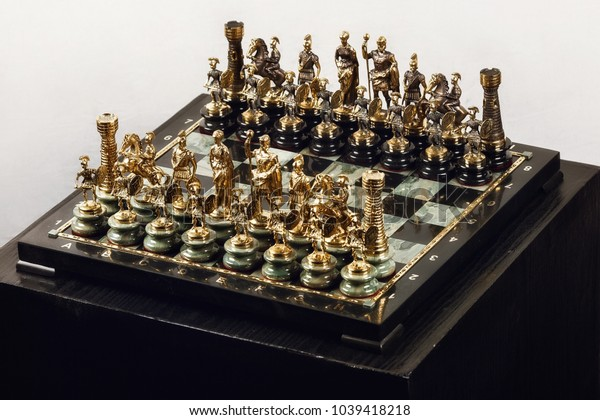 old chess on a stone chessboard
