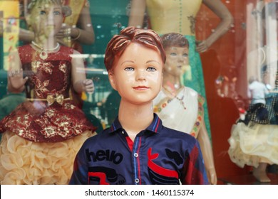 An old child dummy. Boys-mannequins in the shop window of children's clothing. India, Tiruchchirappalli, January 25, 2018.