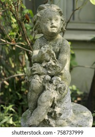 old children statue in a garden