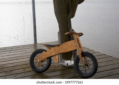 Old children's wooden bicycle in the rain. High quality photo